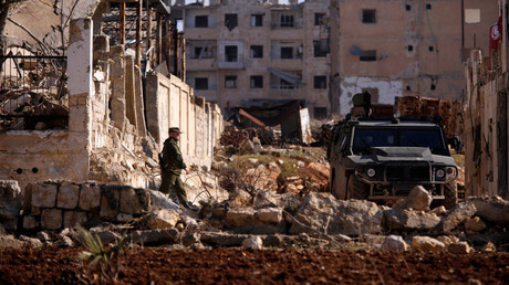 A Russian soldier walks to a military vehicle in goverment controlled Hanono housing district in Aleppo, Syria December 4, 2016. © Omar Sanadiki