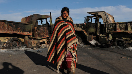 A Navajo Nation woman stands on Highway 1806 during the protests against Dakota Access Pipeline near the Standing Rock Indian Reservation, North Dakota, November 6, 2016 © Stephanie Keith