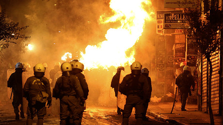 A petrol bomb explodes next to riot police during clashes following an anniversary rally marking the 2008 police shooting of 15-year-old student, Alexandros Grigoropoulos, in Athens, Greece, December 6, 2016 © Alkis Konstantinidis