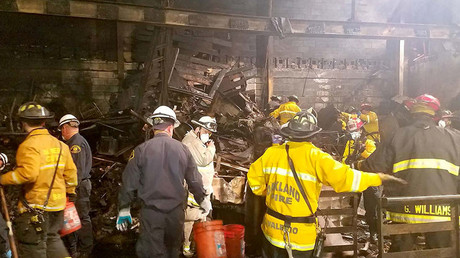 Fire personnel are shown during recovery operations inside the aftermath of a warehouse fire that killed 36 people last week in Oakland California, U.S. in this handout photo released to Reuters December 5, 2016. ©City of Oakland