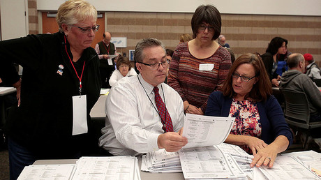 Oakland County clerks count election ballots during a recount of presidential ballots in Waterford Township, Michigan December 5, 2016. © Rebecca Cook