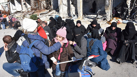 People, who were evacuated from the eastern districts of Aleppo, wait with their belongings in a government held area of Aleppo, Syria, in this handout picture provided by SANA on December 8, 2016 © SANA