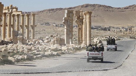 FILE PHOTO  Syrian army soldiers drive past the Arch of Triumph in the historic city of Palmyra © Omar Sanadiki