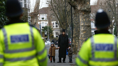 A member of the Jewish community collects his children from school in north London. © Andrew Winning