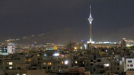 View shows Tehran's skyline at night with the Milad tower © Marius Bosch