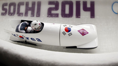 South Korea's pilot Won Yun-jong (front) and Seo Young-woo speed down the track in the men's two-man bobsleigh competition at the 2014 Sochi Winter Olympics February 16, 2014 FILE PHOTO © Fabrizio Bensch