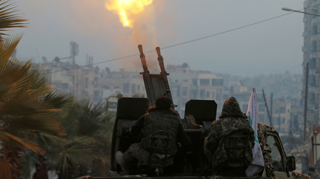 Free Syrian Army fighters fire an anti-aircraft weapon in a rebel-held area of Aleppo  © Abdalrhman Ismail