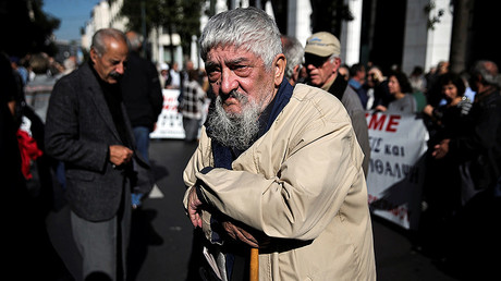 A Greek pensioner leans on a shepherd's crook during a demonstration against planned pension cuts in Athens © Alkis Konstantinidis