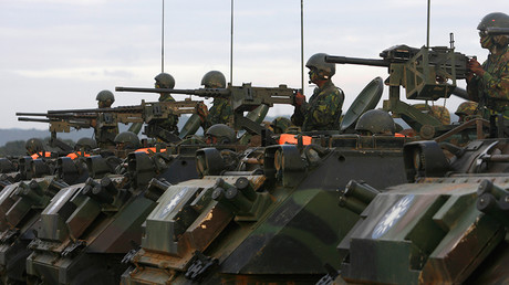 FILE PHOTO: Soldier aim their weapons on CM21A1 armoured infantry fighting vehicles during an army exercise in Hsinchu, central Taiwan  © Nicky Loh