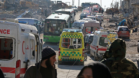 Ambulances and buses wait as they evacuate people from a rebel-held sector of eastern Aleppo, Syria December 15, 2016 © Abdalrhman Ismail