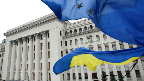 FILE PHOTO Ukrainian national (bottom) and EU flags fly outside the presidential administration building in Kiev © David Mdzinarishvili