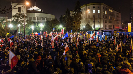 People shout slogans during an anti-government demonstration by opposition supporters and Committee for the Defence of Democracy movement (KOD) outside the Polish parliament on December 16, 2016. © Wojtek Radwanski