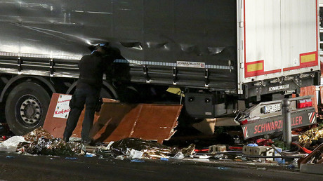 A German police officer looks into a truck at a Berlin Christmas market following an accident with the truck on Breitscheidplatz square near the fashionable Kurfuerstendamm avenue in the west of Berlin, Germany, December 19, 2016. © Christian Mang