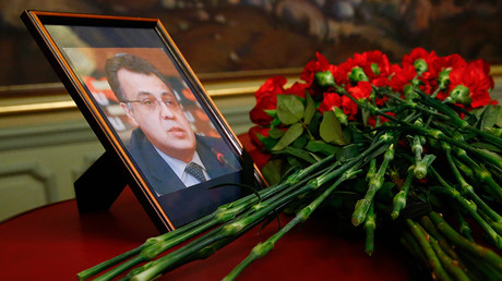Flowers are placed near a portrait of murdered Russian ambassador to Turkey Andrei Karlov during a meeting of Russian Foreign Minister Sergey Lavrov with his Turkish counterpart Mevlut Cavusoglu in Moscow, Russia, December 20, 2016 © Maxim Shemetov