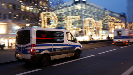 A police car drives near the Christmas market in Berlin, Germany, December 20, 2016 © Hannibal Hanschke