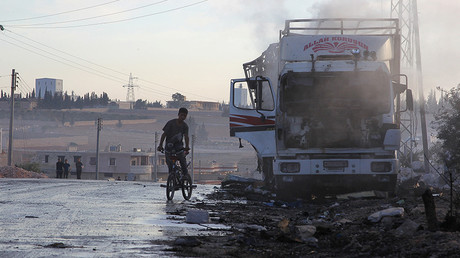 A damaged truck carrying aid is seen on the side of the road in the town of Orum al-Kubra on the western outskirts of the northern Syrian city of Aleppo on September 20, 2016, the morning after a convoy delivering aid was hit by a deadly air strike. © Ammar Abdullah