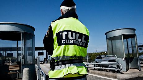File picture shows a Danish custom officers at the Oeresund Bridge border control between Denmark and Sweden © Morten Germund