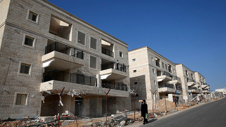 An ultra-Orthodox Jewish man walks past buildings under construction in the Israeli settlement of Beitar Ilit, in the occupied West Bank December 22, 2016. © Baz Ratner
