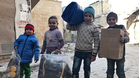 FILE PHOTO. Children receive the first humanitarian aid in eastern Aleppo. ©Mikhail Alaeddin