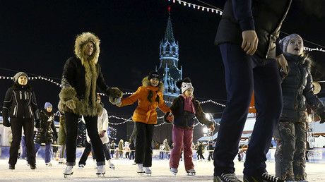 People skate at an ice rink on its first day of operation in front of GUM department store in Moscow's Red Square. © Sergei Karpukhin