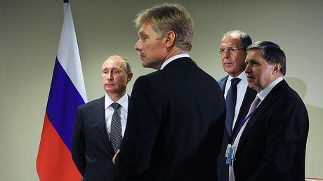 Russian President Vladimir Putin (L) From right: Presidential Aide Yury Ushakov, Russian Foreign Minister Sergey Lavrov, Presidential Spokesman Dmitry Peskov. © Michael Klimentyev