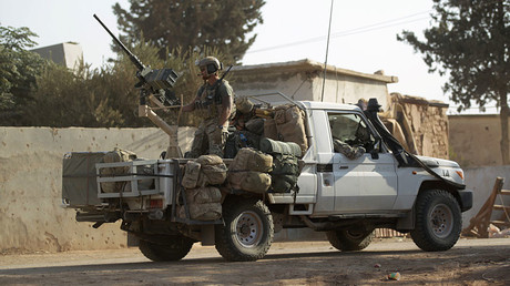 U.S soldiers ride a military vehicle in al-Kherbeh village, northern Aleppo province, Syria October 24, 2016. © Khalil Ashawi