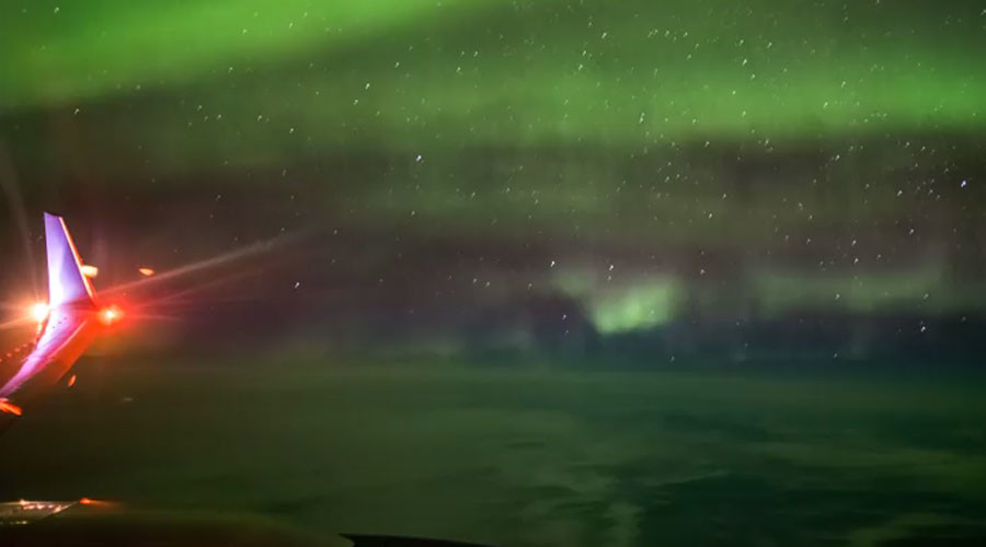 Ethereal Northern Lights captured from 35,000ft by airplane passenger (VIDEO)