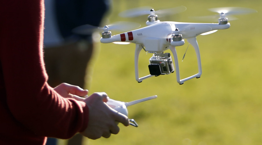Close call: Passenger plane & drone narrowly avoid collision over UK school