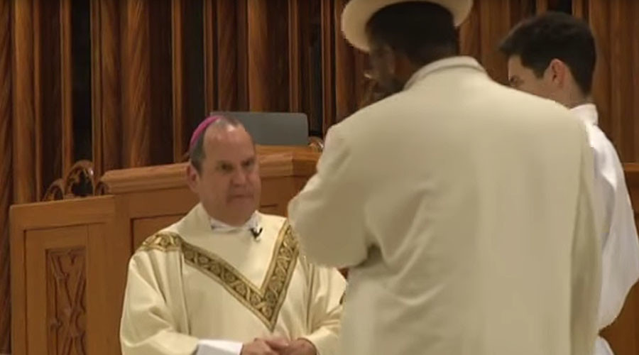 Forgive us our sins: Catholic bishop punched in face during mass (VIDEO)