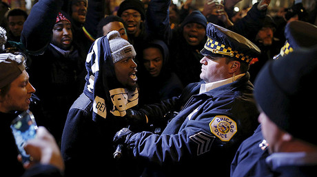 Demonstrators confront police officers during a protest in reaction to the fatal shooting of Laquan McDonald in Chicago, Illinois, November 27, 2015. © Andrew Nelles