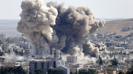 FILE PHOTO: Smoke rises after an U.S.-led air strike in the Syrian town of Kobani. © Umit Bektas