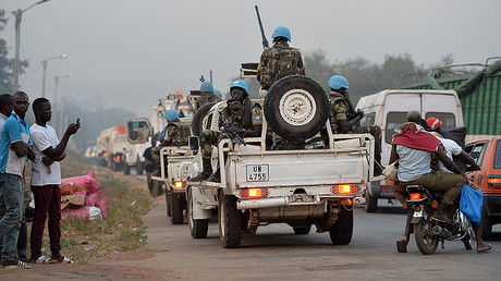 A picture taken in Bouake on January 6, 2017 shows UN Blue Helmet peacekeepers vehicles arriving at the entrance of the city where soldiers demanding more pay and housing rose up earlier in the day. © 