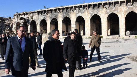 French Les Republicains (LR - The Republicans) party MPs Thierry Mariani (C-L) and Nicolas Dhuicq (C-R) visit the ancient Umayyad mosque in the old city of Aleppo on January 6, 2017 © George Ourfalian