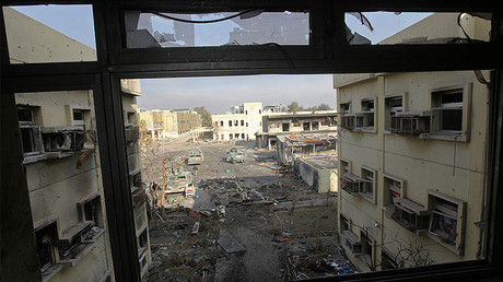 A view from a window at a hospital damaged by clashes during a battle between Iraqi forces and Islamic State militants in the Wahda district of eastern Mosul, Iraq, January 8, 2017. © Alaa Al-Marjani