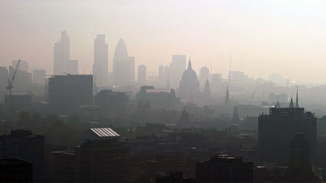 File photo: St. Paul's Cathedral is seen in the early morning sunlight among the skyline through the smog in central London. © Carl de Souza
