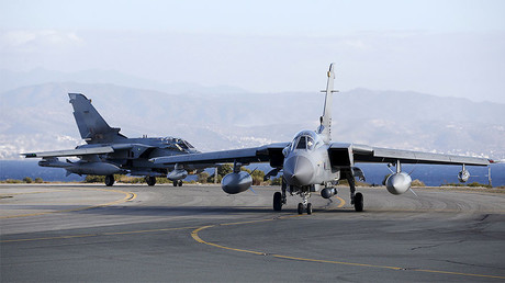 Two British Tornados taxi on the runway, after returning from a mission, at RAF Akrotiri in southern Cyprus. © Darren Staples