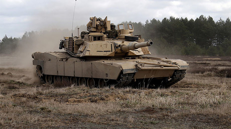 Members of the U.S. 2nd Battalion, 7th Infantry Regiment, 1st Brigade Combat Team, 3rd Infantry Division ride an Abrams tank during an exercise at Mielno range near Drawsko-Pomorskie. File photo.© Kacper Pempel