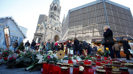 FILE PHOTO: Flowers and candles are placed at the Christmas market at Breitscheid square in Berlin, Germany, December 30, 2016, following an attack by a truck which ploughed through a crowd at the market © Fabrizio Bensch