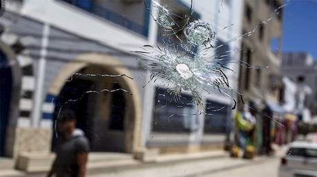 A bullet hole pockmarks the window of a car parked in the street where the gunman who attacked the Imperial Marhaba resort was killed, in Sousse, Tunisia, June 30, 2015. © Zohra Bensemra