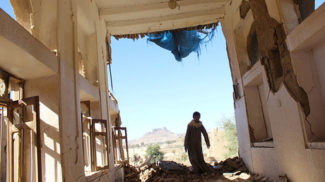 A boy walks inside a house destroyed by a recent Saudi-led air strike in the northwestern city of Saada, Yemen January 4, 2017. ©Naif Rahma