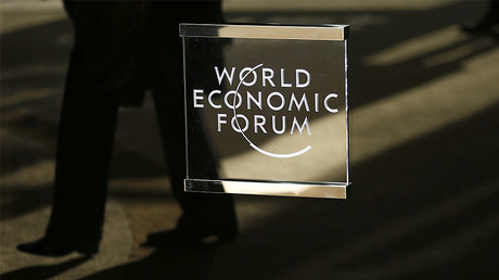 A man walks past the official logo of the World Economic Forum (WEF) in Davos, Switzerland January 16, 2017. © Ruben Sprich