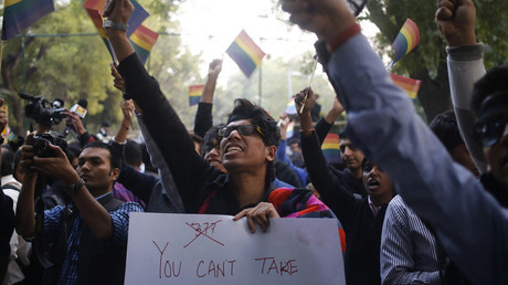 FILE PHOTO: Gay rights activists wave flags and shout slogans as they attend protest against a verdict by the Supreme Court in New Delhi © Anindito Mukherjee