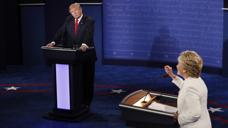FILE PHOTO: Republican U.S. presidential nominee Donald Trump listens as Democratic U.S. presidential nominee Hillary Clinton speaks during their third and final 2016 presidential campaign debate at UNLV in Las Vegas, Nevada, U.S., October 19, 2016. © Mark Ralston