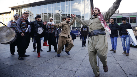 FILE PHOTO Migrants dance in front of the railway station  in Cologne, Germany © Wolfgang Rattay