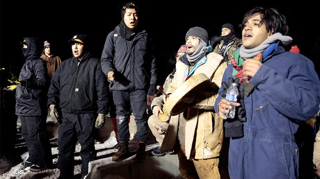 Opponents of the Dakota Access oil pipeline sing during a confrontation with police on Backwater Bridge near Cannon Ball, North Dakota, U.S., January 19, 2017 © Terray Sylvester