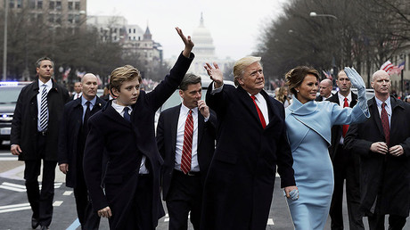 U.S. President Donald Trump, first lady Melania Trump and son Barron walk during the inaugural parade from the U.S. Capitol in Washington, U.S., January 20, 2017. © Pool