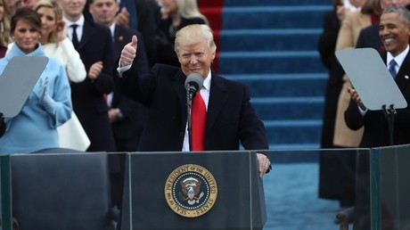 First lady Melania Trump (L) and outgoing U.S. President Barack Obama (R) looks on as U.S. President Donald Trump gives a thumbs up after being sworn in as the 45th president of the United States on the West front of the U.S. Capitol in Washington, U.S., January 20, 2017. © Carlos Barria