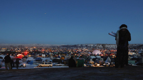 A woman looks at the Oceti Sakowin camp as activists celebrate news that Dakota Access Pipeline will be denied easement for building near the Standing Rock Indian Reservation, North Dakota, December 4, 2016 © Lucas Jackson