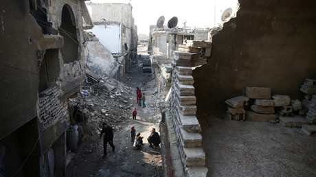 People walk in a damaged neighbourhood in the rebel held besieged city of Douma © Bassam Khabieh