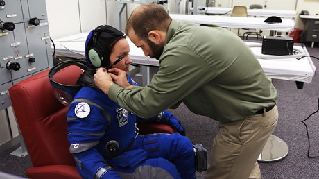 A suit technician fits the communications carrier on an astronaut stand-in before pressurizing the spacesuit inside Crew Quarters at NASAKennedy Space Center in Florida © NASA / Cory Huston